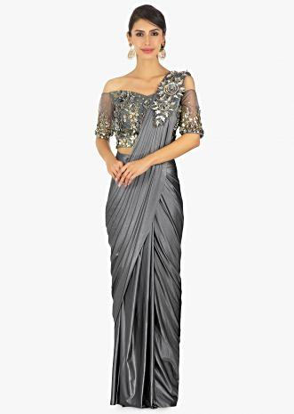 Wrap around lycra saree with presstitched pleats and pallo paired with an embellished net blouse