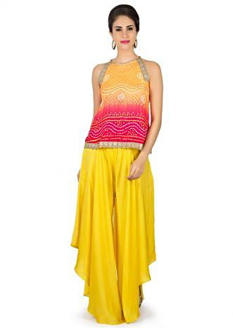 Orange and red bandhani top with yellow fancy palazzo pant only on Kalki