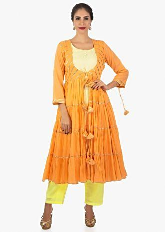 Yellow cotton kurti pant paired with apricot jacket with gathers