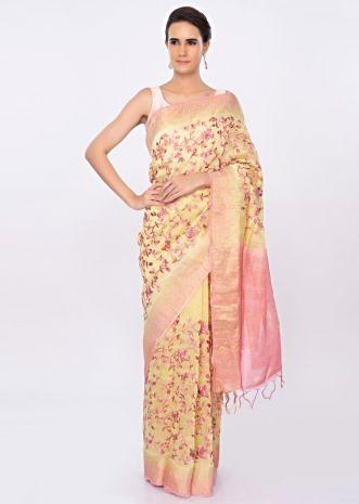 Yellow linen saree with pink floral jaal embroidery only on kalki