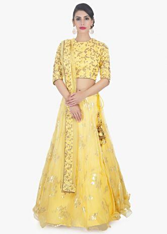 Yellow organza weaved lehenga with thread embroidered net blouse and net dupatta