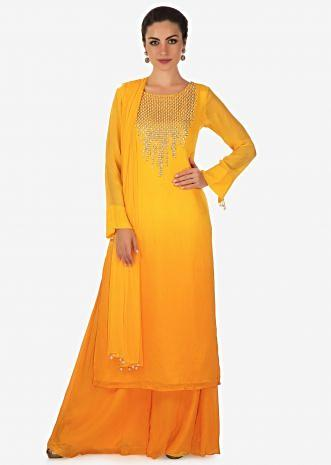 Yellow shaded palazzo suit with moti and sequin work only on Kalki
