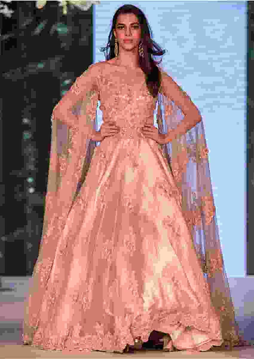 Light lilac pink gown in embroidered net with fancy sleeve