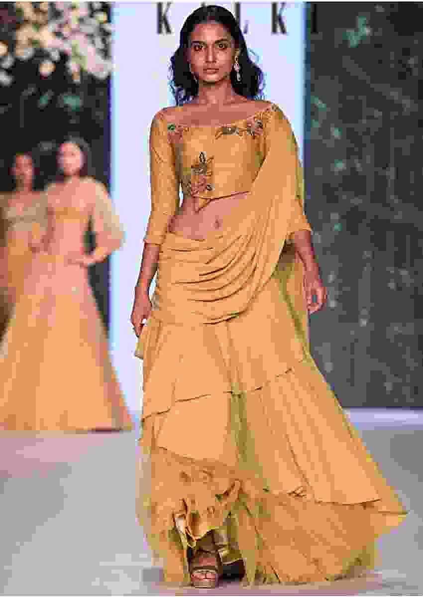Corn Mustard Layered Lehenga With Raw Silk Blouse And Pre Stitch Dupatta Online - Kalki Fashion