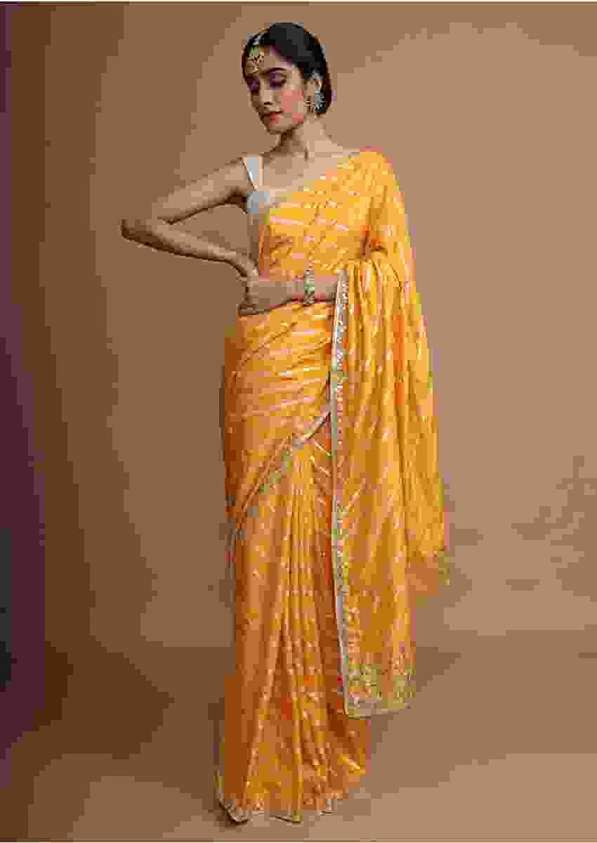 Amber Yellow Saree In Silk With Gotta Work Stripes And Gotta Patti Embroidered Leaf Motifs On The Border Online - Kalki Fashion