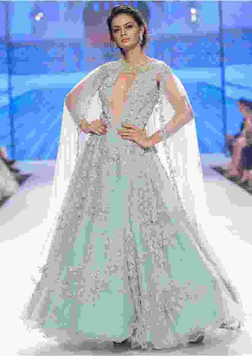 Aviary blue  flared net gown with double circular pattern and  net trail