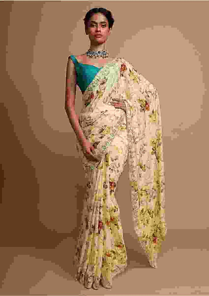 Blonde yellow floral printed chiffon saree with gotta and moti embroidered border Online - Kalki Fashion