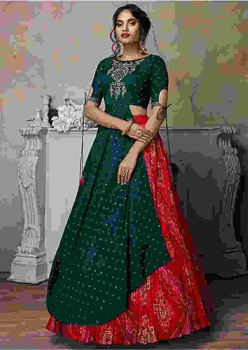 Bottle Green Asymmetric Long Choli Paired With Red Bandhani Printed Lehenga Online - Kalki Fashion