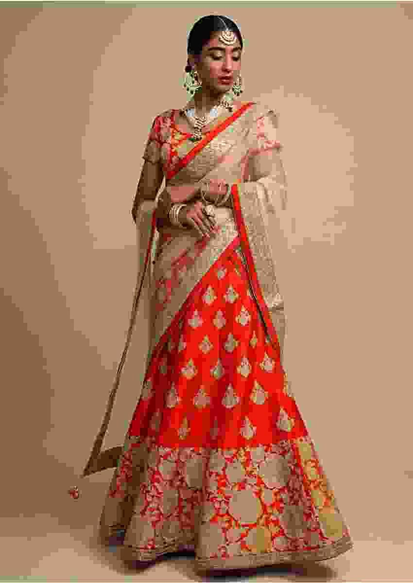 Candy Red Lehenga Choli In Raw Silk With Zari Embroidered Roses On The Hem And Floral Buttis Online - Kalki Fashion