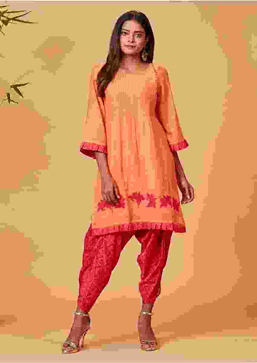 Carrot Orange Dhoti Suit With Floral Applique  Online - Kalki Fashion