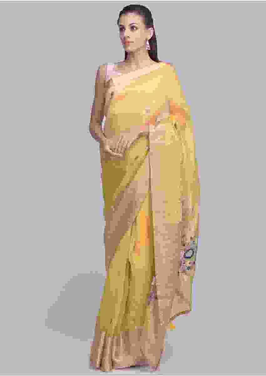 Chrome yellow organza saree with floral butti only on Kalki