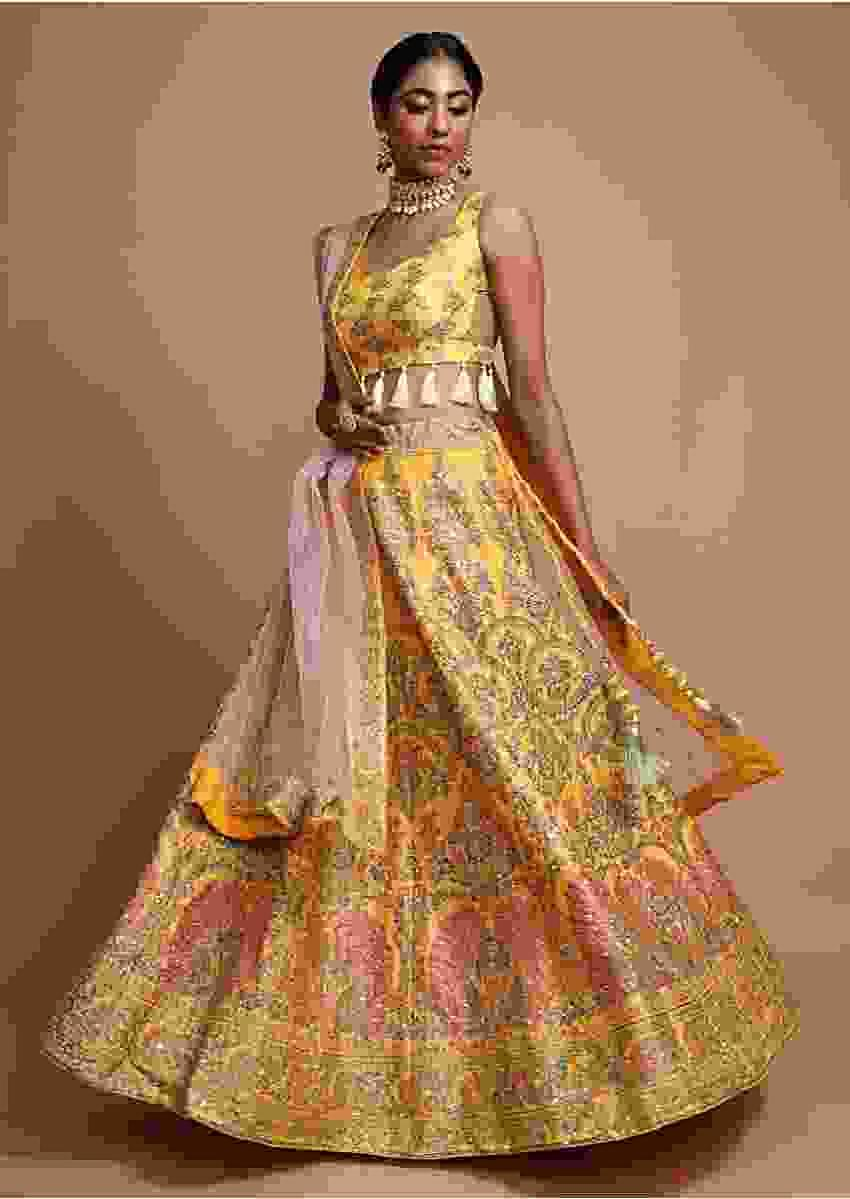 Chrome Yellow Silk Lehenga Choli With Foil Printed Peacock And Floral Motifs Online - Kalki Fashion
