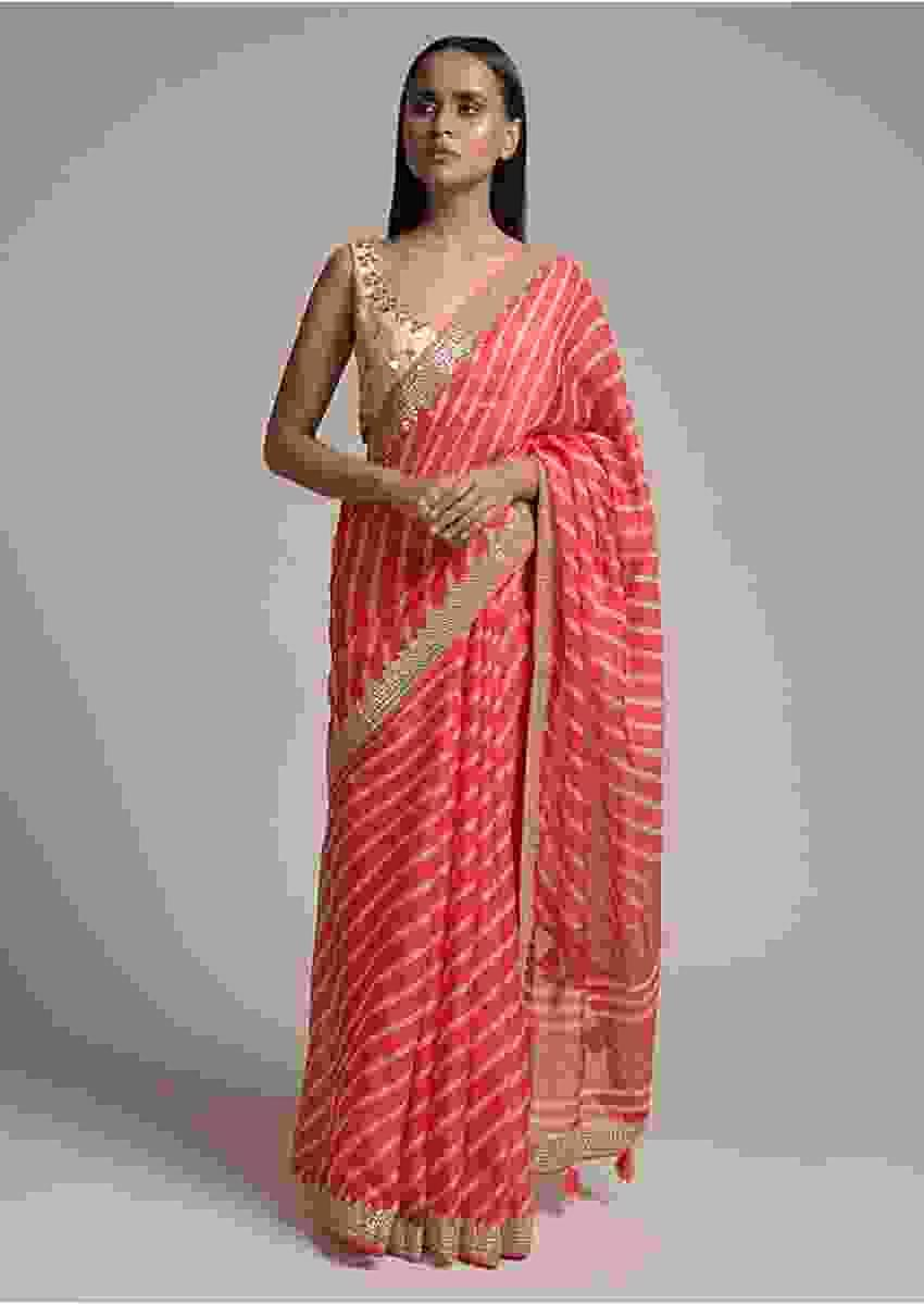 Coral Pink Saree With Lehariya Print And Paisley Motifs On The Pallu Along With Gotta Border Online - Kalki Fashion