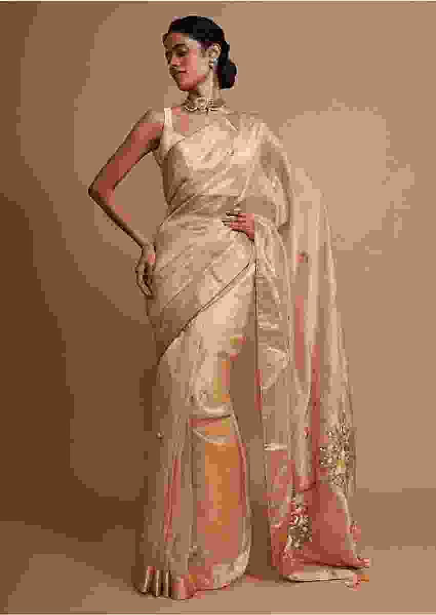 Dark cream organza saree with hand embroidered floral buttis Online - Kalki Fashion