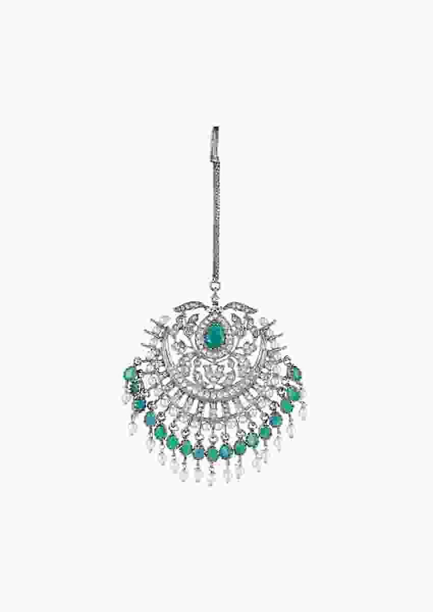 Grey Plated Mang Tika With Faux Emeralds, Diamonds And Pearls In An Ethnic Design By Aster