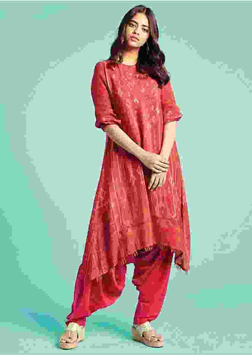 Hot Pink Dhoti Suit Crepe With Orange And Green Tribal Print Online - Kalki Fashion