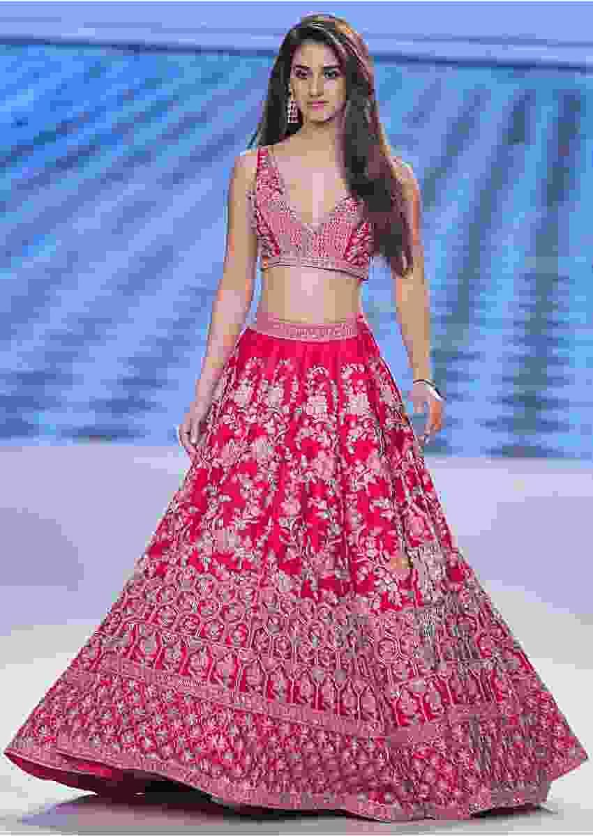 Disha Patani in Kalki mesmerising pink raw silk lehenga set in multi color resham, ari and zardosi embroidery.