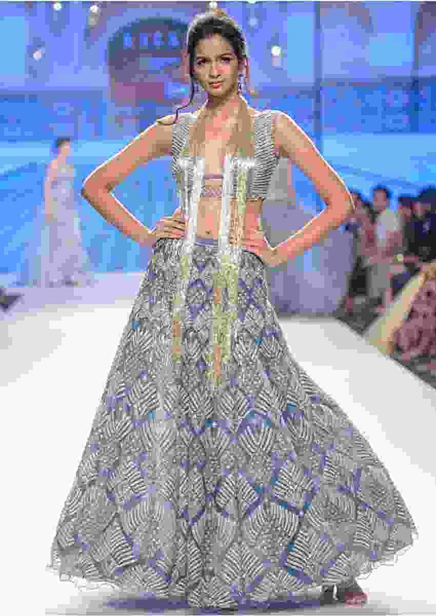Iris blue net lehenga and blouse with  attached net  drape with side slits