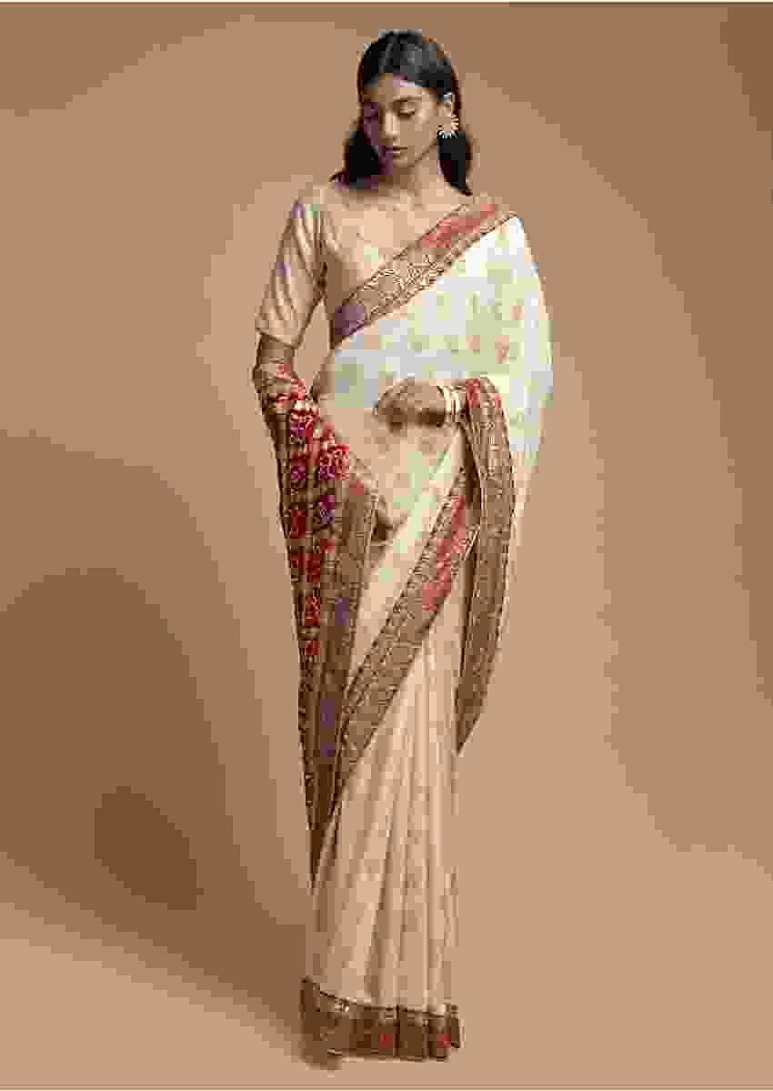 Ivory Beige Saree In Silk With Weaved Floral Buttis And Bandhani Printed Pallu Online - Kalki Fashion