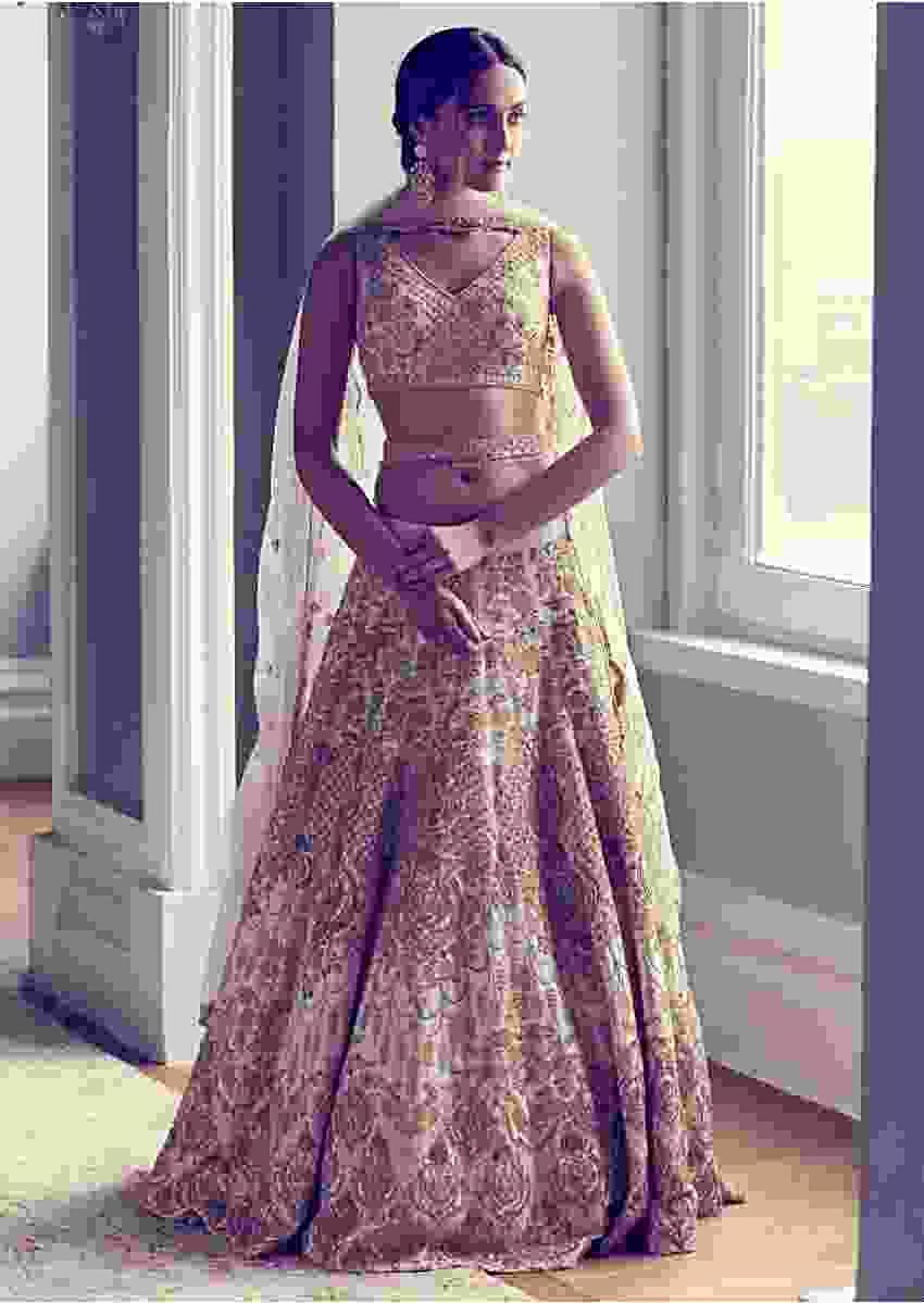 Ivory Lehenga Choli In Raw Silk Accentuated With Hand Embroidery In Floral Motifs Online - Kalki Fashion
