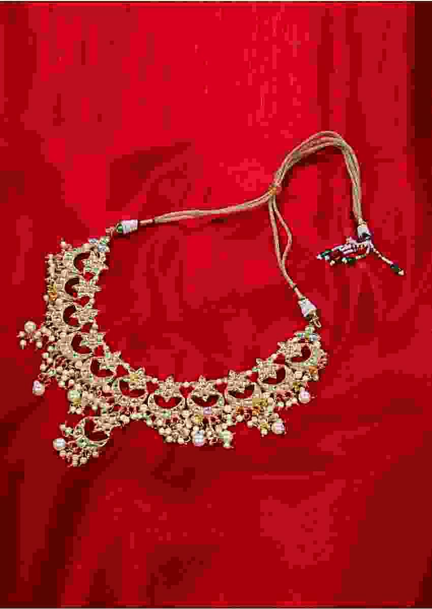 Kundan and pearl studded collar necklace in moon and star motifs only on kalki