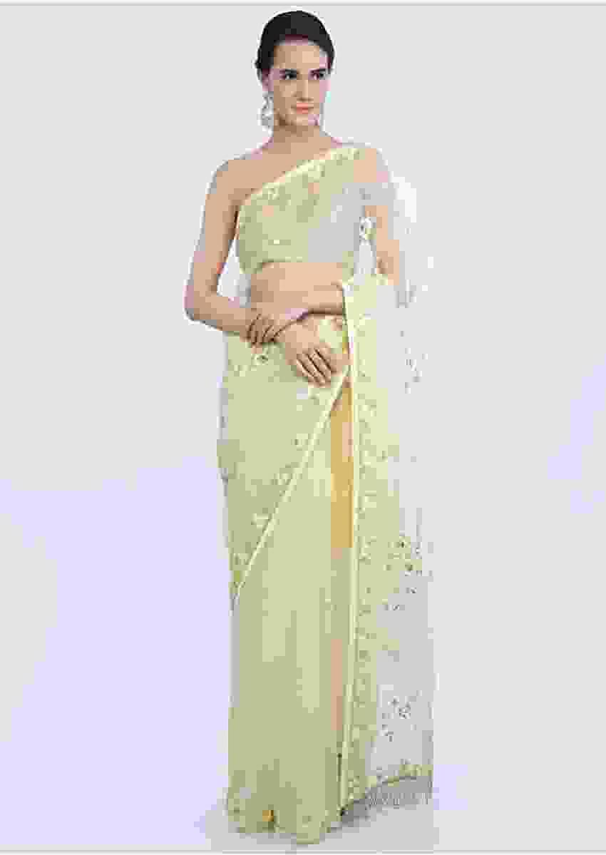 Lemon green organza saree with floral embroidered butti and border only on Kalki