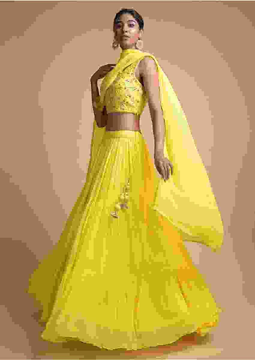 Lemon Yellow Lehenga In Tiered Pattern And Jaal Embroidered Sleeveless Choli Online - Kalki Fashion