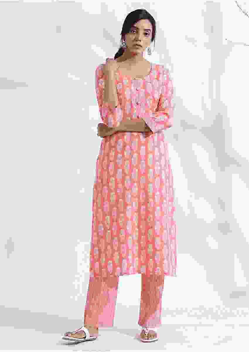 Light pink printed kurta set in cotton with bald work Online - Kalki Fashion