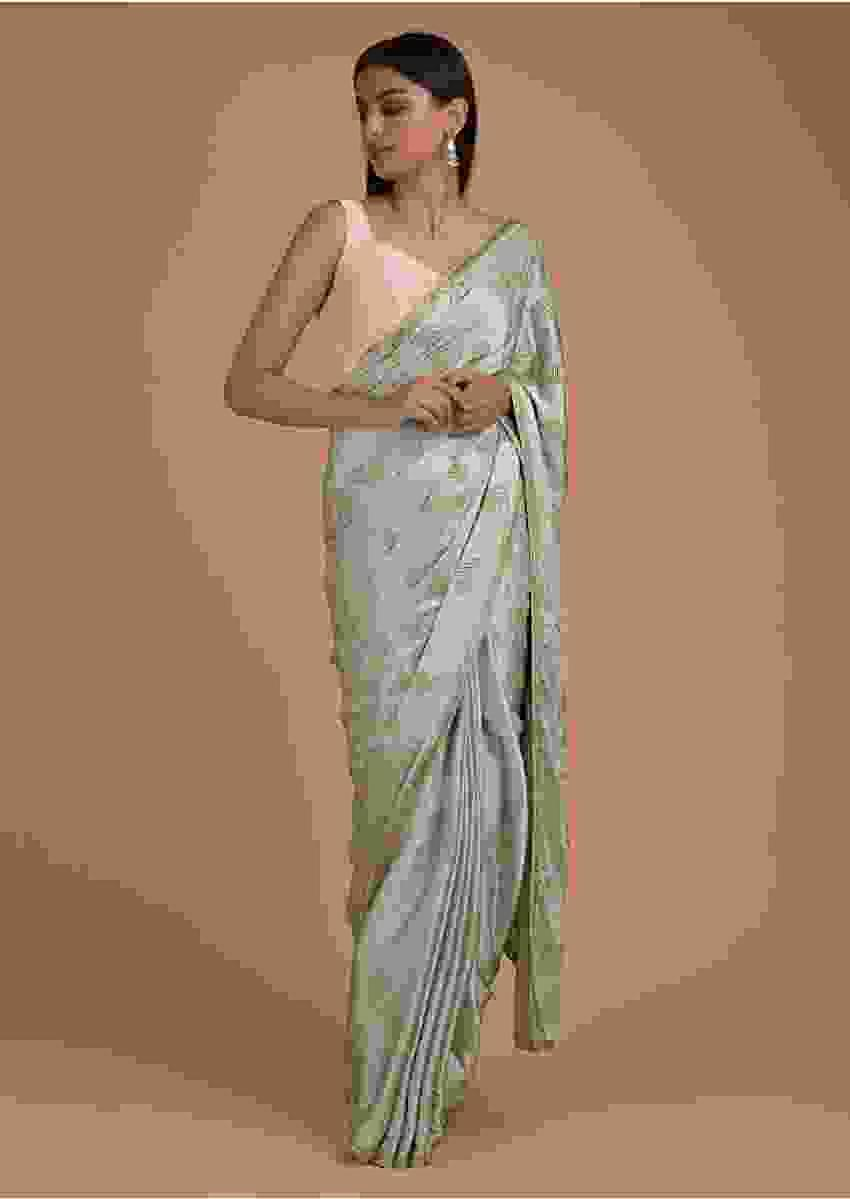Marina Green Saree In Satin Adorned With Cut Dana Embellished Peacock Feather Motifs Online - Kalki Fashion