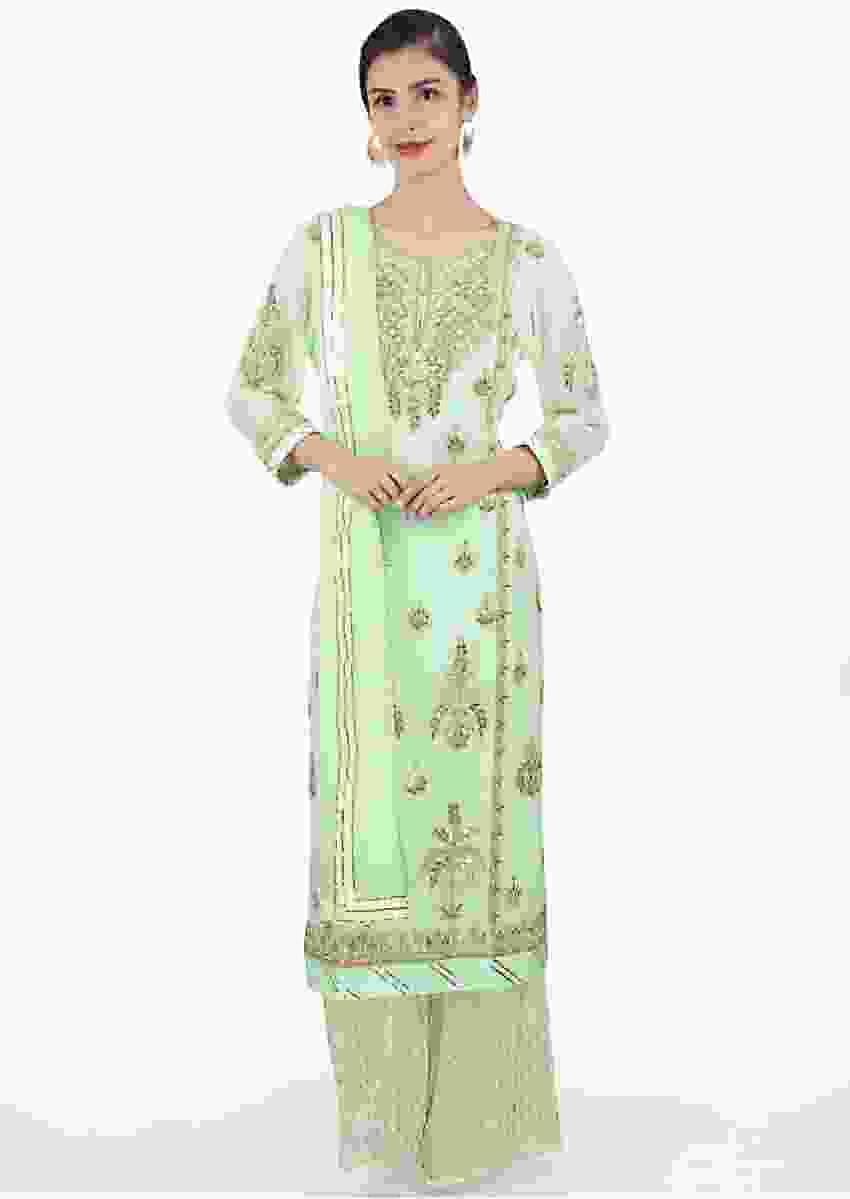 Mint green georgette suit in straight kali paired with weaved palazzo and matching chiffon dupatta