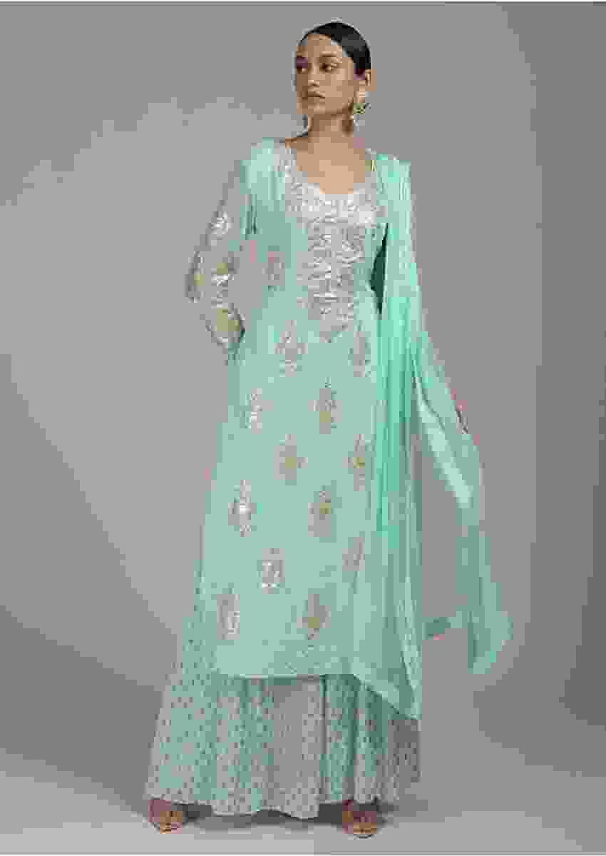 Sea green georgette suit set in zari butti and border