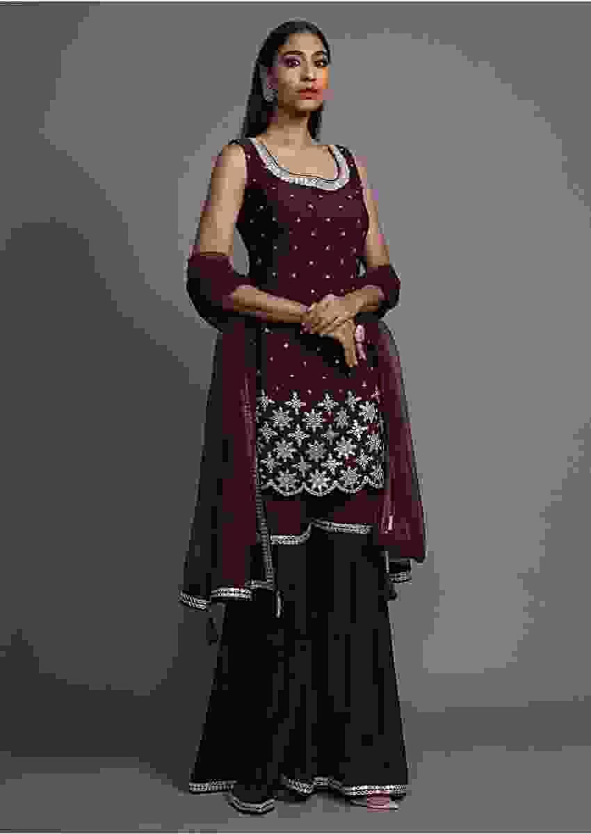 Mulberry Purple Sharara Suit Adorned With Mirror And Thread Work Floral Buttis On The Scallop Hem Online - Kalki Fashion
