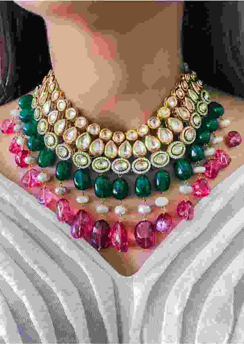 Multi Color Necklace Decorated With Exquisite Kundan, Sparkling Stones, Pearls And Green And Pink Dangling Beads  By Prerto