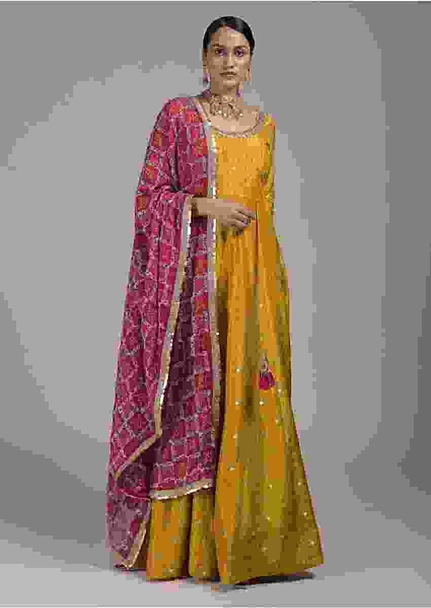Mustard Yellow Anarkali Suit In Silk With Woven Buttis And Mirror Embellished Neckline Online - Kalki Fashion