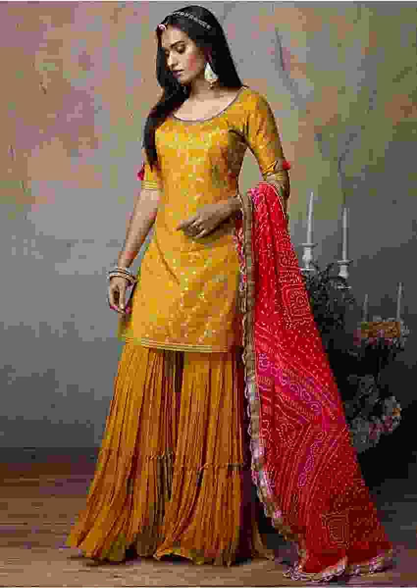 Mustard Yellow Sharara Suit With Pink And Red Shaded Bandhani Dupatta Online - Kalki Fashion