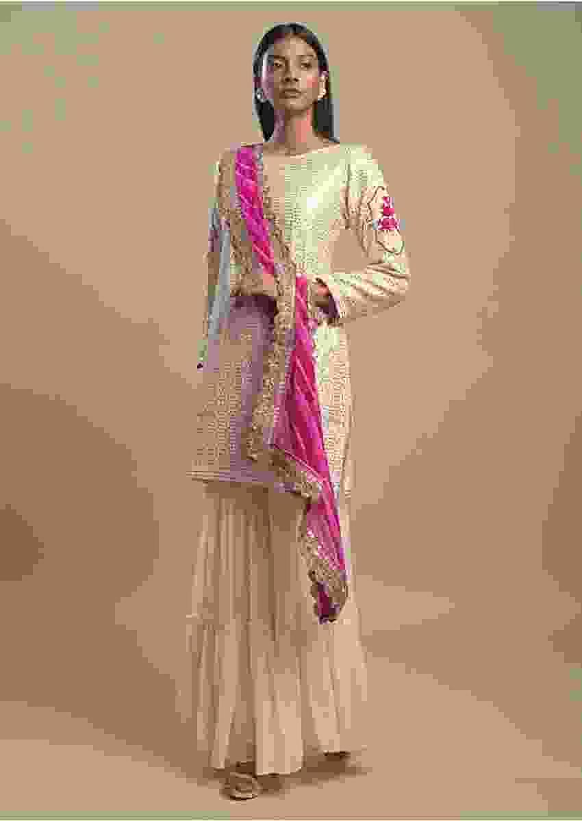 Off White Sharara Suit In Cotton Silk With Flower Shaped Sequins All Over And Lehariya Dupatta Online - Kalki Fashion