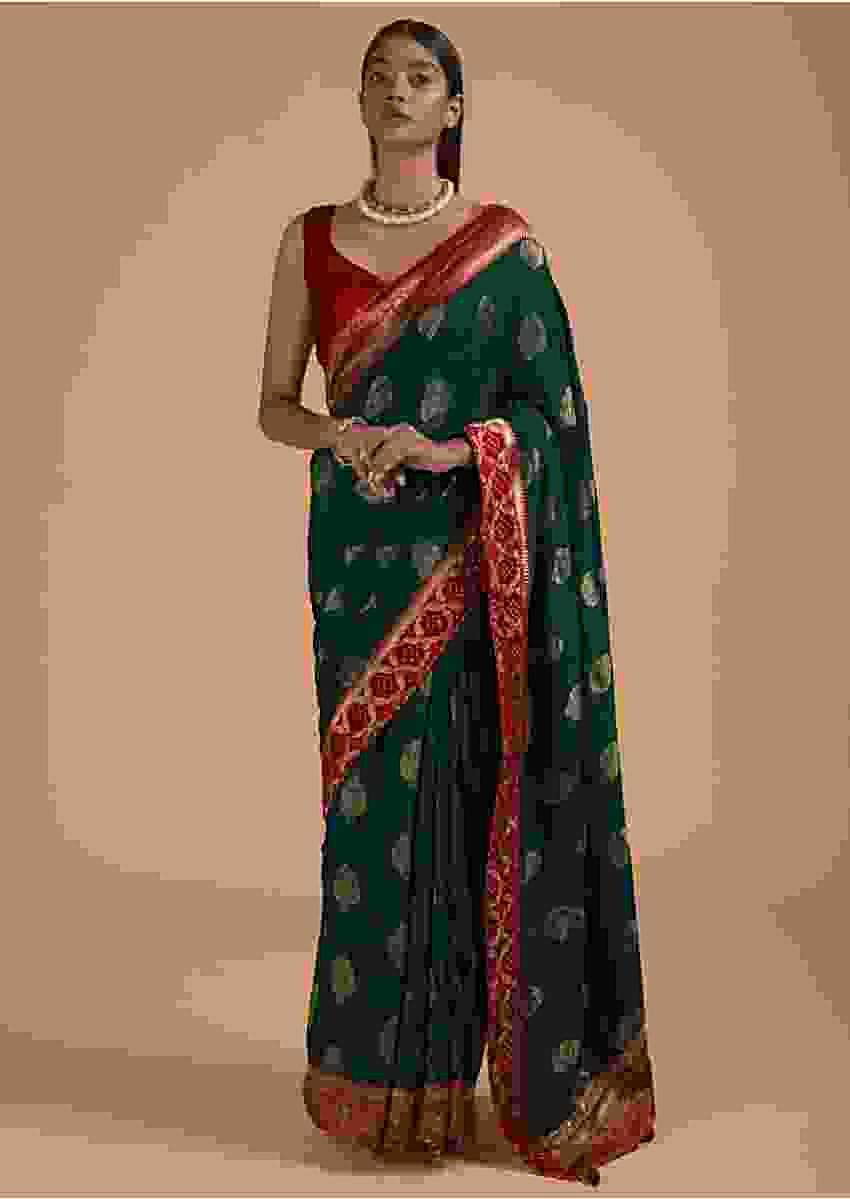 Peacock Blue Saree In Dola Silk With Brocade Leaf Shaped Buttis And Contrast Red Bandhani Border Online - Kalki Fashion
