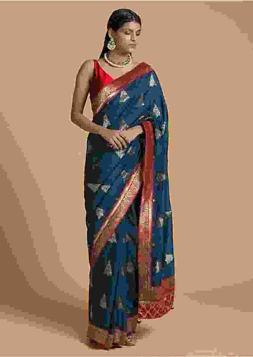 Peacock Blue Saree In Dola Silk With Brocade Woven Triangular Buttis And Contrast Red Border Online - Kalki Fashion