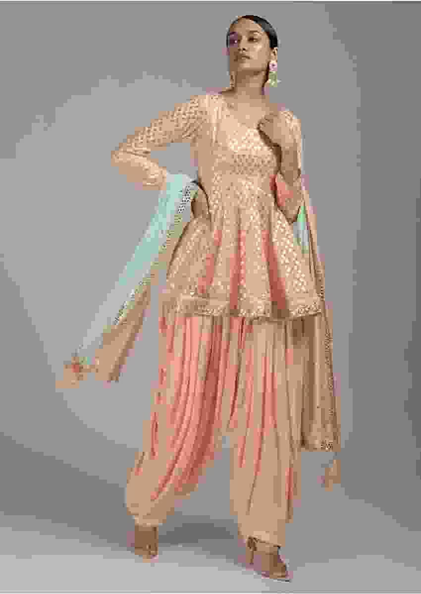 Powder Peach Salwar Suit With Peplum Kurti Enhanced With Brocade Buttis Online - Kalki Fashion
