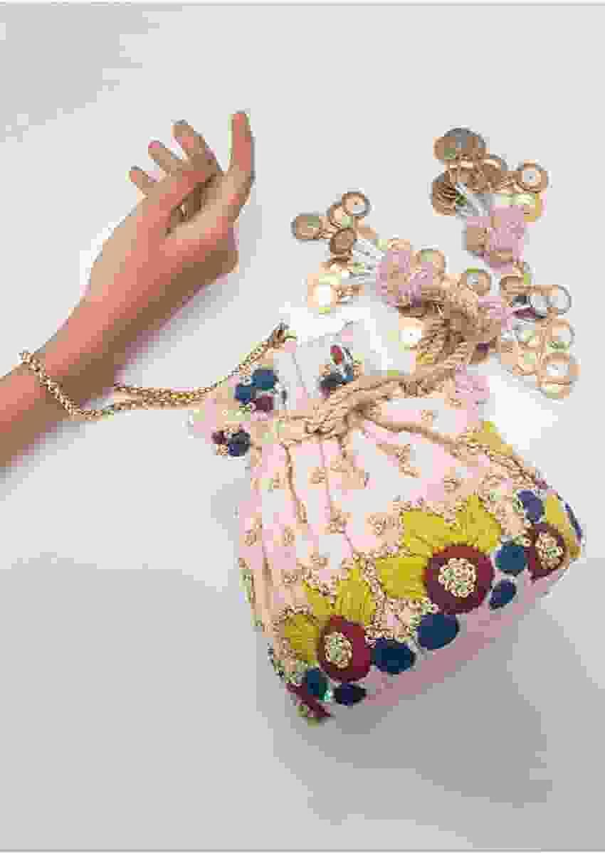 Powder Pink Potli With Hand Embroidered Resham And Pita Work In Floral Design By Vareli Bafna