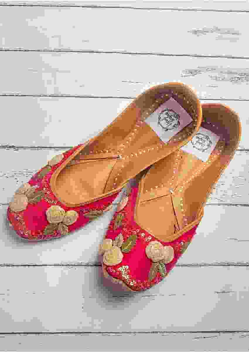 Rani Pink Juttis In Raw Silk With Handmade 3D Flowers, Zardozi And Sequins Work By Vareli Bafna