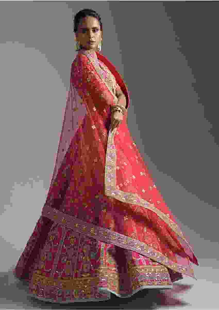 Rani Pink Lehenga Choli In Raw Silk With Heavy Embroidery Zardosi Work In Mughal And Floral Design Online - Kalki Fashion