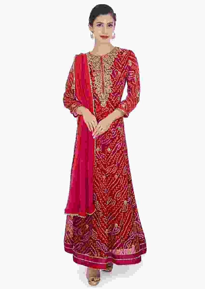 Red bandhani georgette anarkali suit paired with rani pink chiffon dupatta with lace border