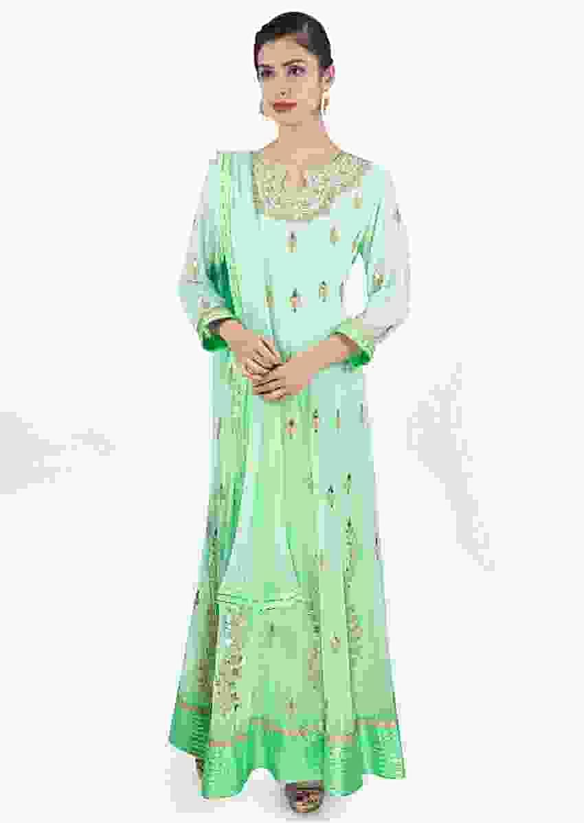 Sea green georgette anarkali dress paired with matching chiffon net dupatta