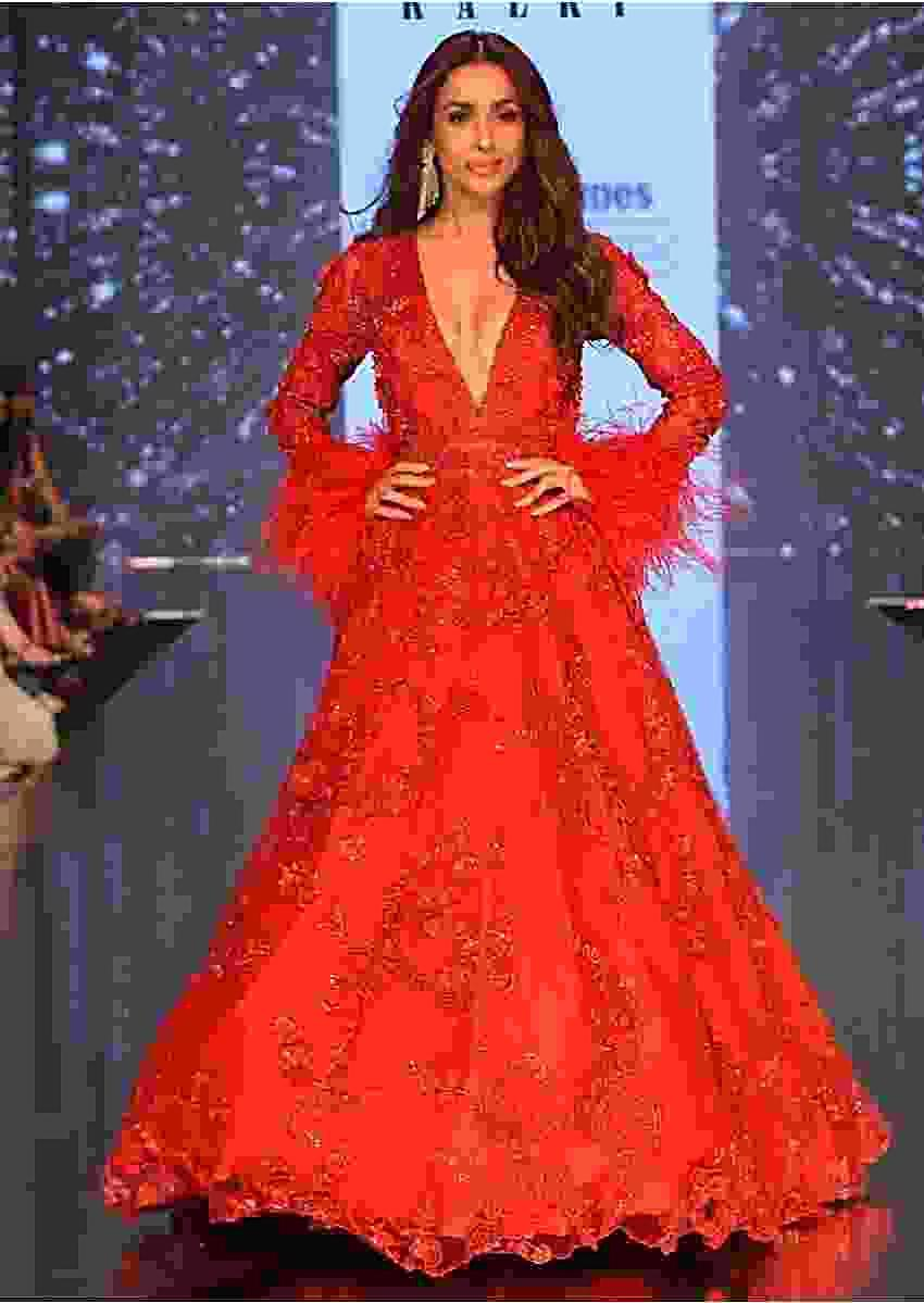 Showstopper Malaika Arora in Kalki's Ruby Red Embroidered Net Gown with Feather Sleeves