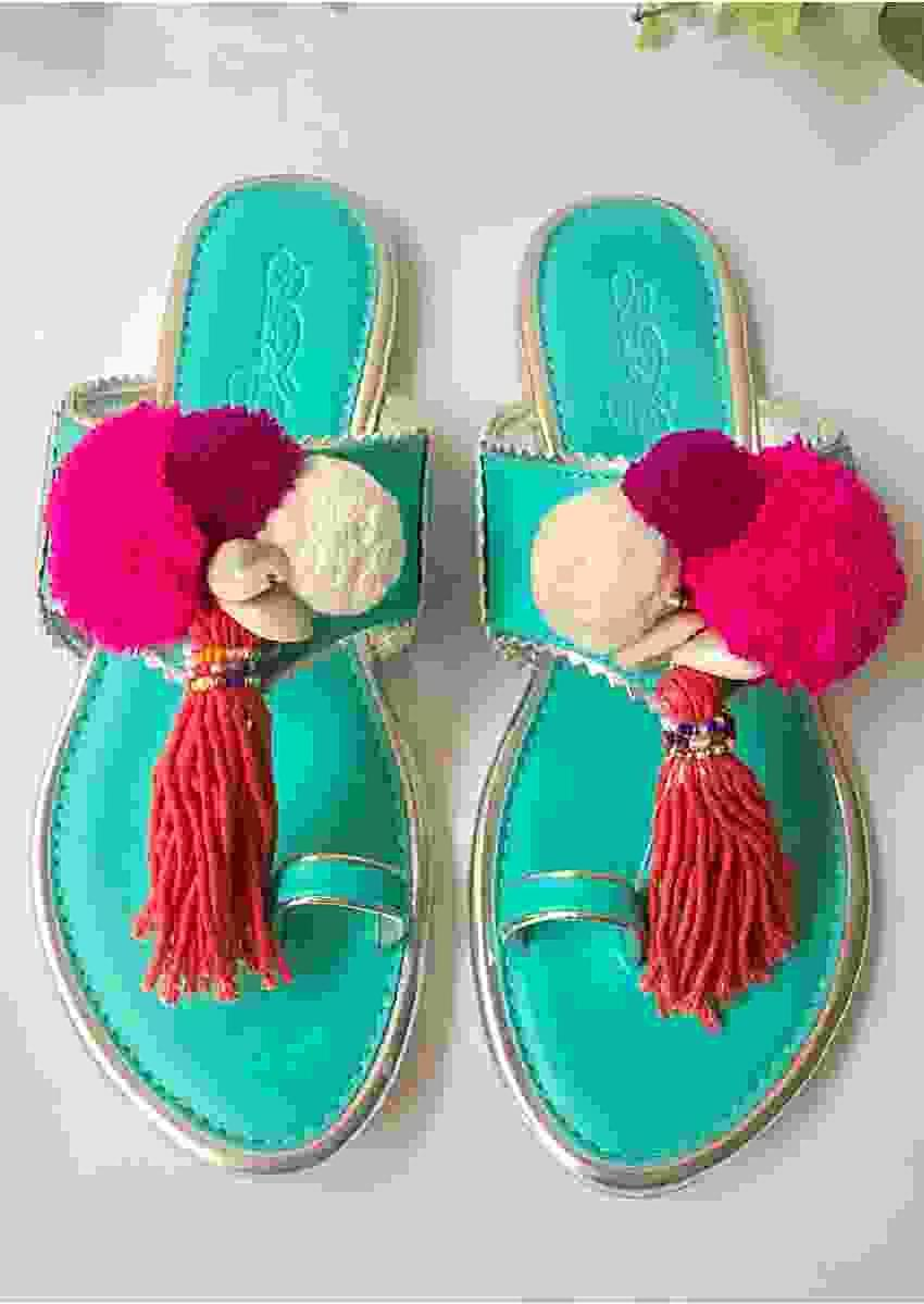 Turquoise Kolhapuri Flats With Accents Of Multicoloured Pompoms, Shells And Tassels Online By Sole House