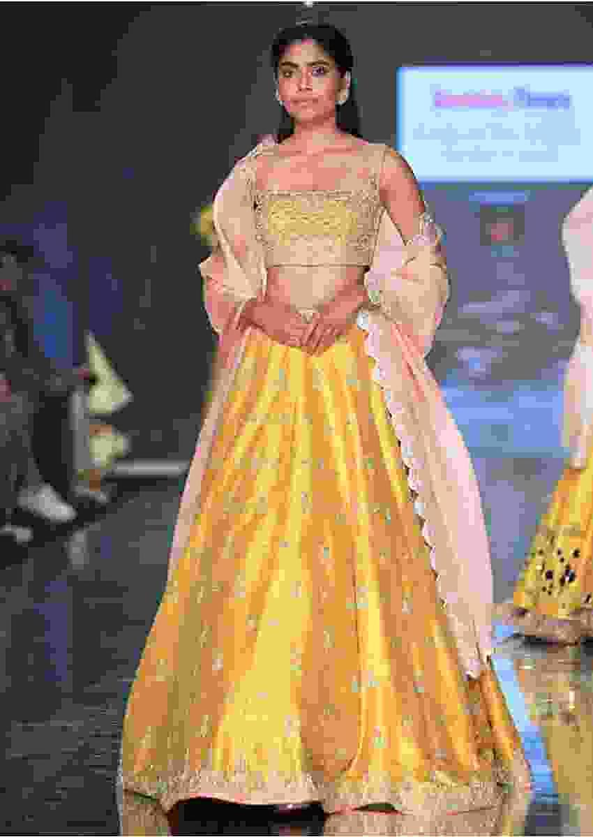 Sunset Yellow Lehenga Choli With Hand Embroidered Buttis Online - Kalki Fashion