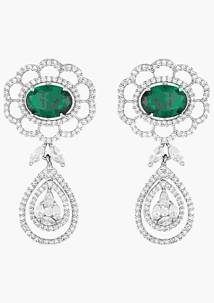 White Rhodium Plated Earrings With Faux Diamonds And Emerald In Floral Motif By Aster