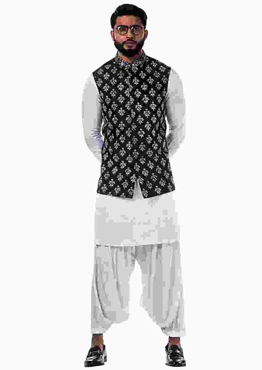 White Kurta Set In Linen Satin With A Black Silk Nehru Jacket With White Cord Floral Embroidery Online - Kalki Fashion