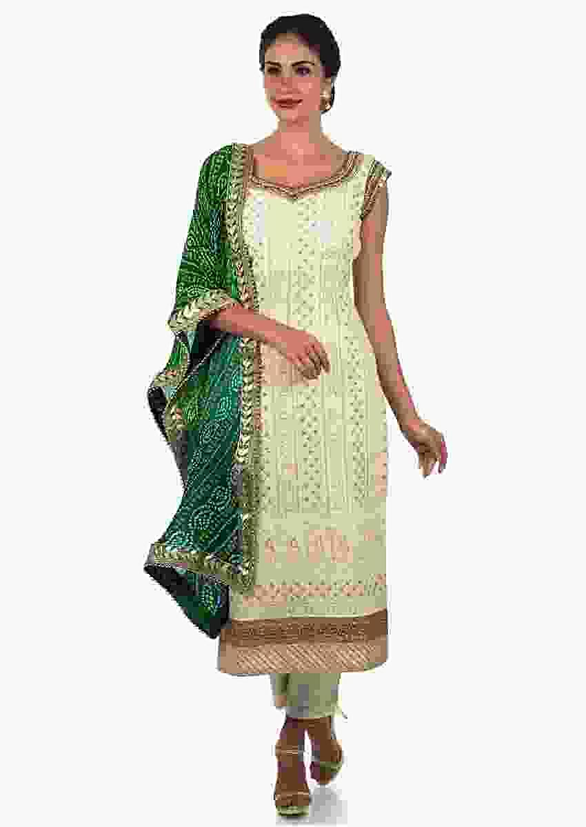 White Suit With Green Bandhni Dupatta Adorn In Lucknowi Thread Embroidery Work Online - Kalki Fashion